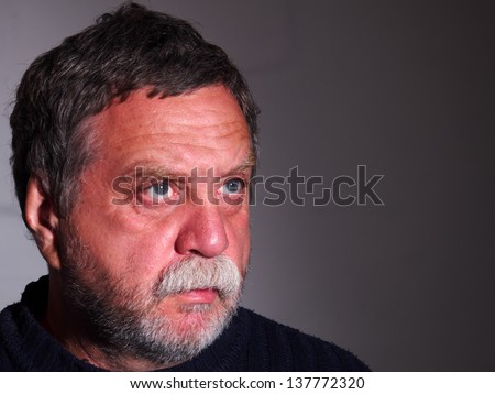 tanned, bearded middle-aged man - stock photo