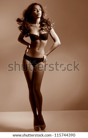 tanned brunette with a gorgeous figure - stock photo