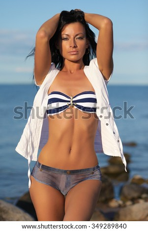 Tanned girl on the nature. Beautiful tanned girl - stock photo