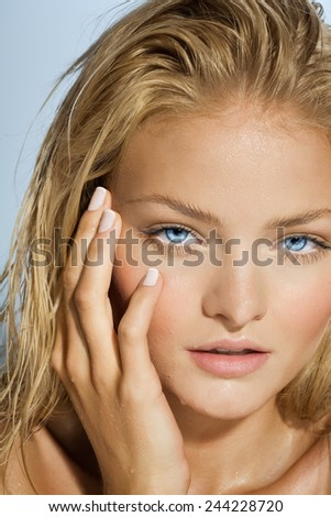 Tanned model with wet face. - stock photo