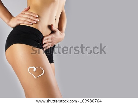 Tanned skinny girl in the studio - stock photo