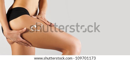 Tanned skinny woman in the studio