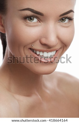 Tanned young girl smiling