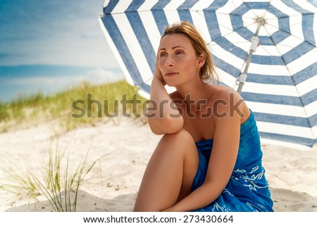 tanning brown relaxing horizon watchning female - stock photo