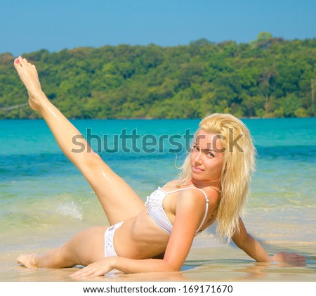 Tanning Gracefully Sexy Blonde