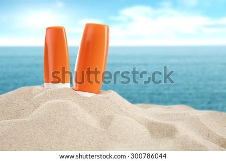 tanning oil on sand  - stock photo