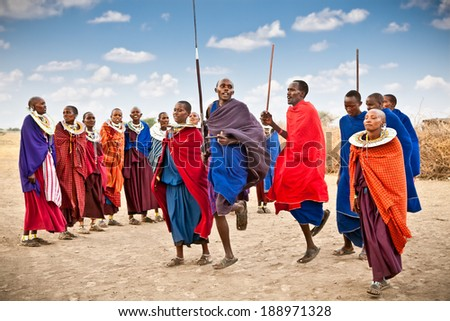 TANZANIA, AFRICA-FEBRUARY  9, 2014: Masai warriors dancing traditional jumps as cultural ceremony,review of daily life of local people on February 9, 2014. Tanzania. - stock photo