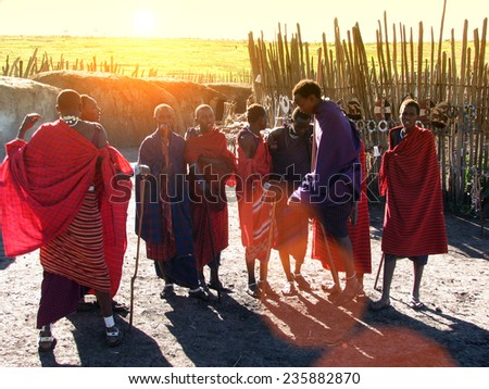 TANZANIA, AFRICA - NGORONGORO, 26 JANUARY 2006: Masai warriors dancing traditional jumps as cultural ceremony,review of daily life of local people - stock photo