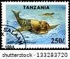 "TANZANIA - CIRCA 1994: Postage stamps printed in Tanzania shows a Monachus tropicalis, with the same inscription, from the series ""Endangered Species"" circa 1994 - stock photo"