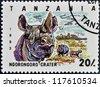 TANZANIA - CIRCA 1993: Stamp printed in Tanzania dedicated to Ngorongoro crater, shows rhinoceros, circa 1993 - stock photo