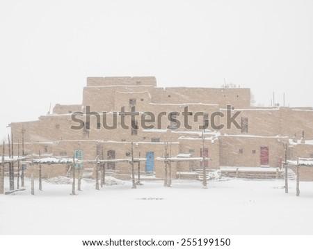 Taos Pueblo is an ancient pueblo belonging to a Tiwa-speaking Native American tribe of Pueblo people. - stock photo