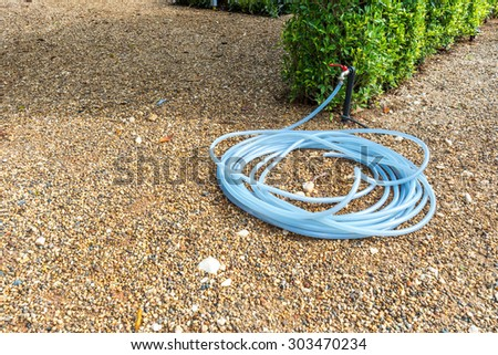 Tap and the hose in carden