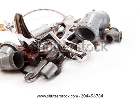 Tap for hot and cold water, spanners, components for plumbing - stock photo