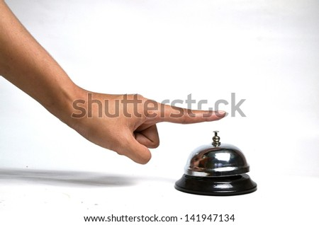 Tap the bell. - stock photo