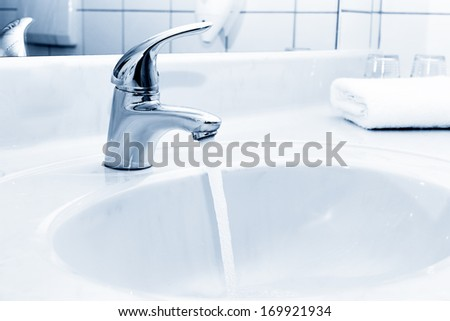tap water in the bathroom - stock photo