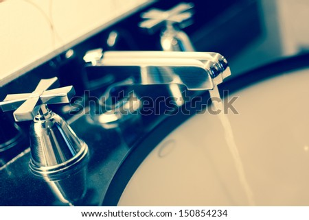 Tap water running. Water conservation eco friendly concept - stock photo