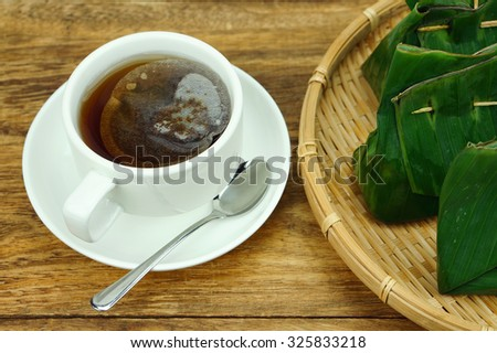 Tapai and cup of tea. Tapai is a traditional food in Malaysia - stock photo