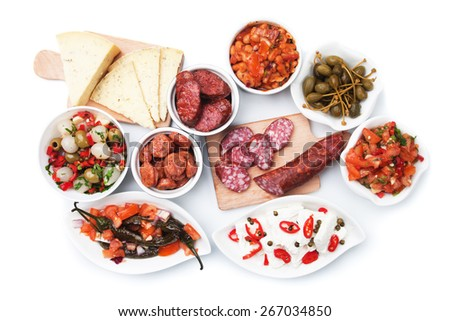 Tapas, antipasto or meze, mediterranean cold buffet food isolated on white background - stock photo