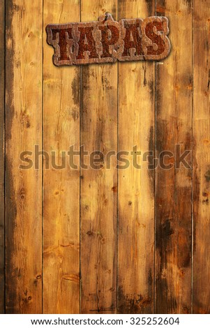 tapas signboard nailed to a wooden wall - stock photo