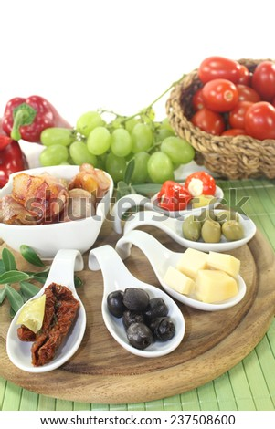 Tapas stuffed with prunes, figs and apricots on a light background