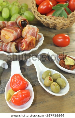 Tapas stuffed with prunes, figs, apricots on wooden background - stock photo