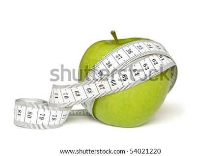 tape measure and green apple