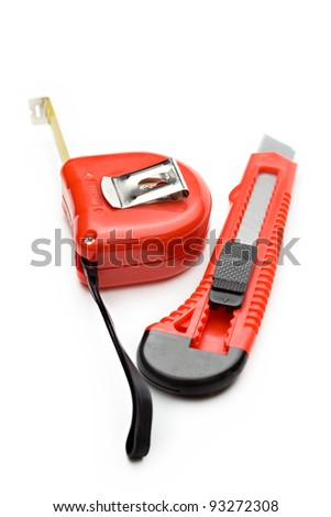 Tape measure and paper knife - stock photo