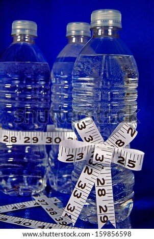 tape measure bow on bottled water - stock photo