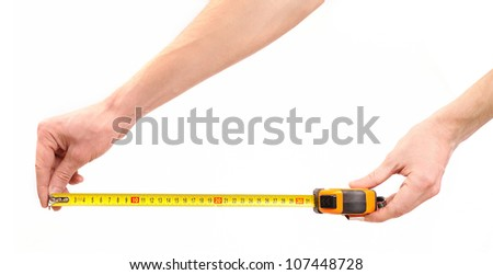 Tape measure in man hands - stock photo