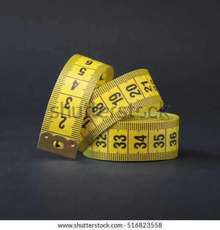 tape measure. metric system. Black background