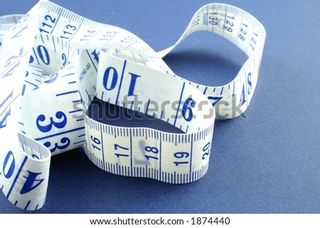 Tape measure on a blue background
