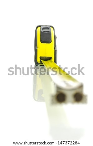 Tape measure on white desk with reflection. With empty space ready for your text. - stock photo