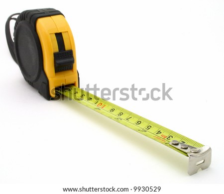tape measure over a white surface - stock photo