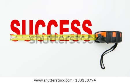 Tape measure over word of success isolated on white background - stock photo