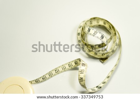 Tape measure showing 77 with white background