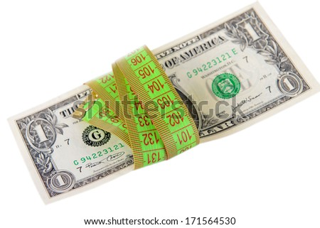 Tape measure with money isolated on white - stock photo
