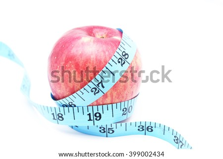 Tape measure wrapped around the apple on white background,healthy concept