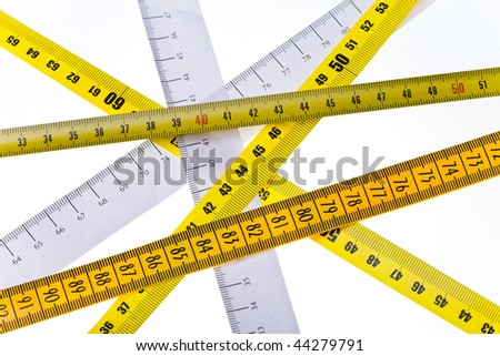tape measures cross on white background