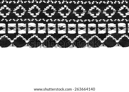 Tape of black cotton lace on white background