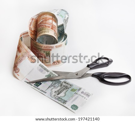 Tape of Russian money with scissors - stock photo