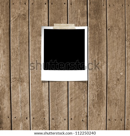 Taped polaroid style photo frame - stock photo