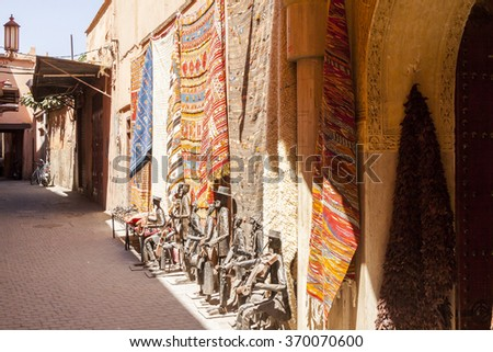 Tapestry and sculptures at market in Morocco - stock photo