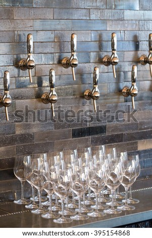 Taphouse in Portland Oregon with multiple tap handles for craft beer and wine. - stock photo