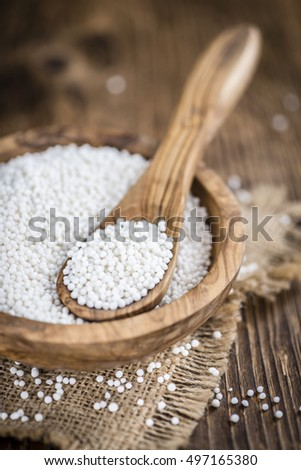 Tapioca Pearls (close-up shot) on rustic wooden background (selective focus)