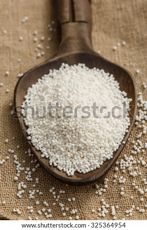 Tapioca pearls on a wooden spoon - stock photo