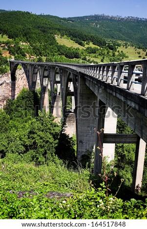 Tara Bridge over green Tara Canyon. - stock photo
