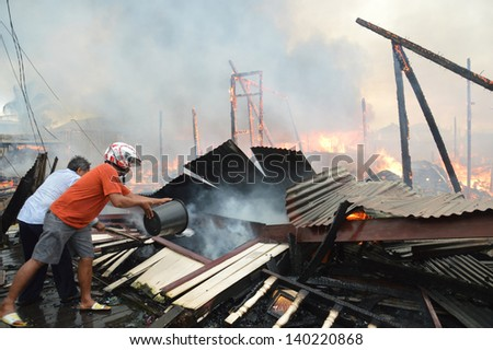 TARAKAN, INDONESIA - MAY 29: Fires in densely populated urban waterfront on May 29, 2013 at Tarakan, Indonesia