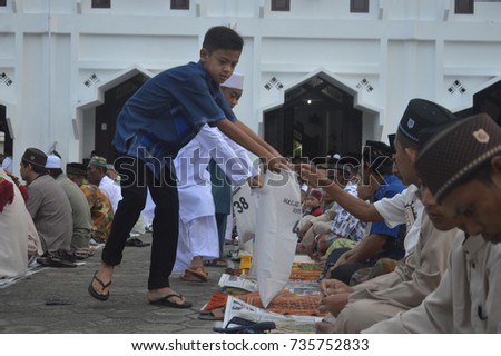 TARAKAN, INDONESIA - 25th June 2017 : The Muslim community performs Eid prayers at the mosque and the mosque courtyard of Al Ma'rif Kota Tarakan Indonesia in the morning after a month of fasting