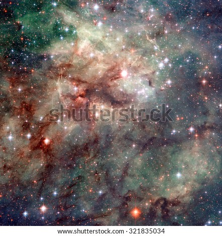 Tarantula Nebula is the star-forming region of ionised hydrogen gas is in the Large Magellanic Cloud, a small galaxy. Retouched image. Elements of this image furnished by NASA. - stock photo