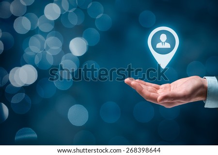 Target customer and human resources (HR) concept, beautiful bokeh in background. Man hold target customer, employee (or another business person) in hand.